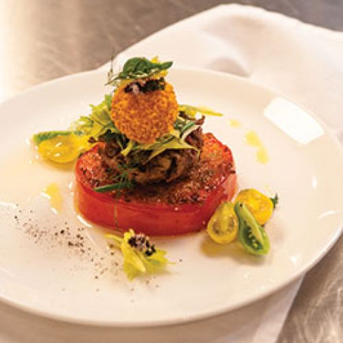 Vaudeville's Crispy Heirloom Tomato with Wild Boar  Rillettes, Herb Salad, and Gazpacho Sorbet
